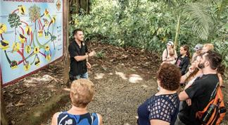 Guide introducing tourists to the history of cocoa and culture