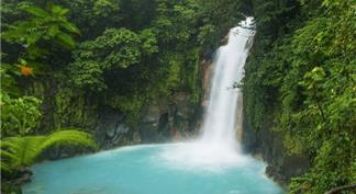 Light blue colored river and waterfall