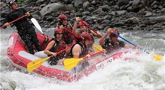 Pepople on float raft in the whitewater river