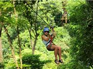 Woman sliding on zip line